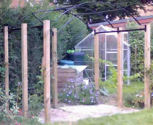 Rose arch, built to utilise existing wooden uprights in horsham